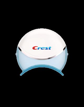 Crest 3D White Whitestrips with Light - Teeth Whitening Kit. Zestaw zawiera 20 pasków wybielających plus jedną lampę.